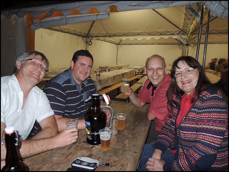 Graham, Luther Greg Hoeher and Sigrid Wengert enjoying a drink together.