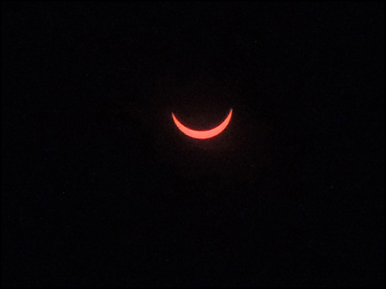 The partial solar eclipse as seen from outside our marquee.