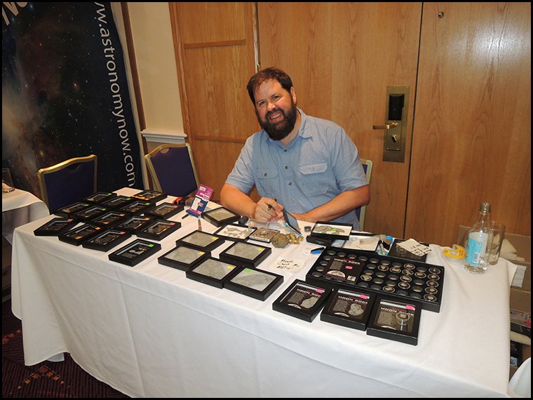 Steve Arnold arranging his meteorites for sale.